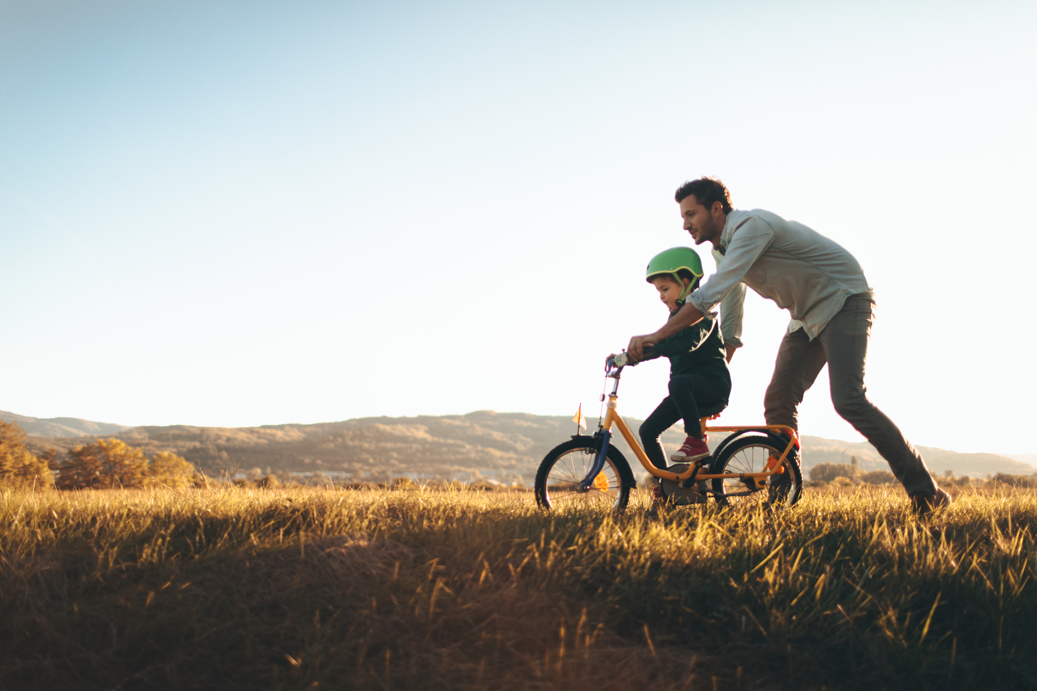 father-and-son-on-a-bicycle-lanejpg